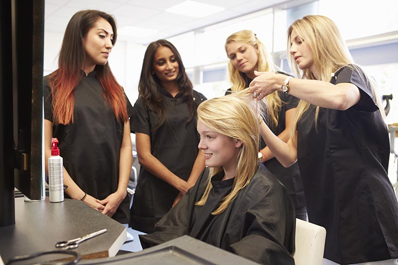 Teacher and Students Learning Hairdressing